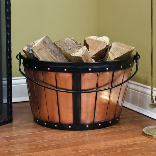 a faux wooden basket with firewood will add a cozy farmhouse feel to the space