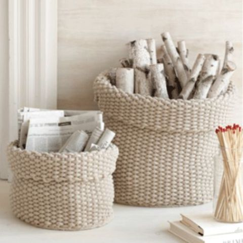 crochet baskets can be used for storing anything, from firewood to other stuff and in every space