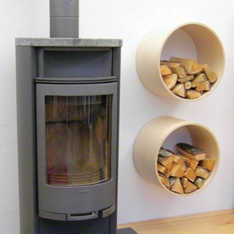 whitewashed plywood round firewood holders can be attached to the wall next to the fireplace
