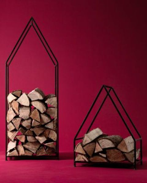laconic metal firewood stands shaped as houses are a cool and bold idea with a cozy feel