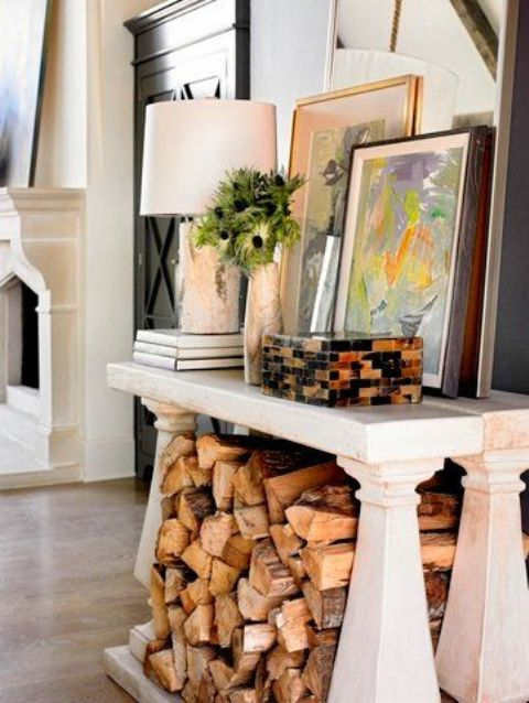 a vintage console table with firewood under the tabletop is a very cool and stylish idea for almost any space