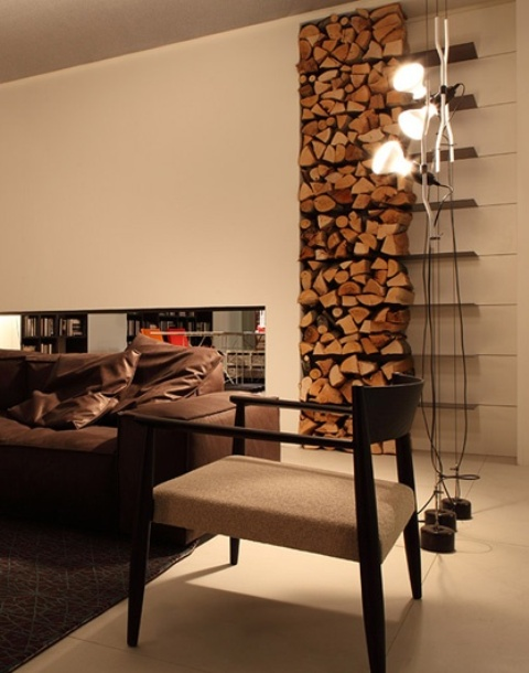 a minimalist tiered open firewood storage attached to the wall is a stylish feature that brings coziness in here