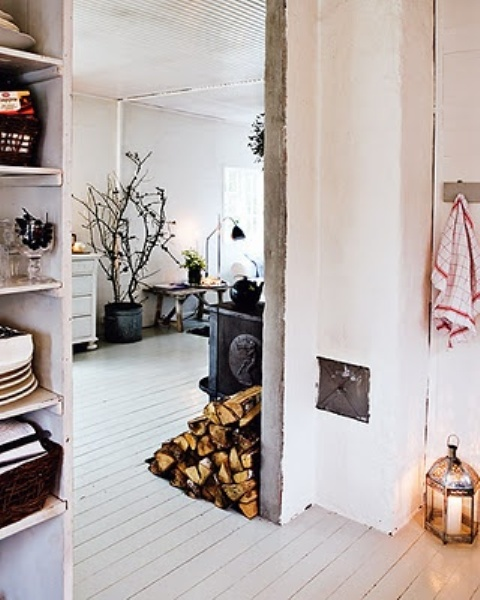 firewood stored right on the floor is a cool solution for a Nordic, rustic or woodland-inspired interior and you needn't puzzle over where to place it