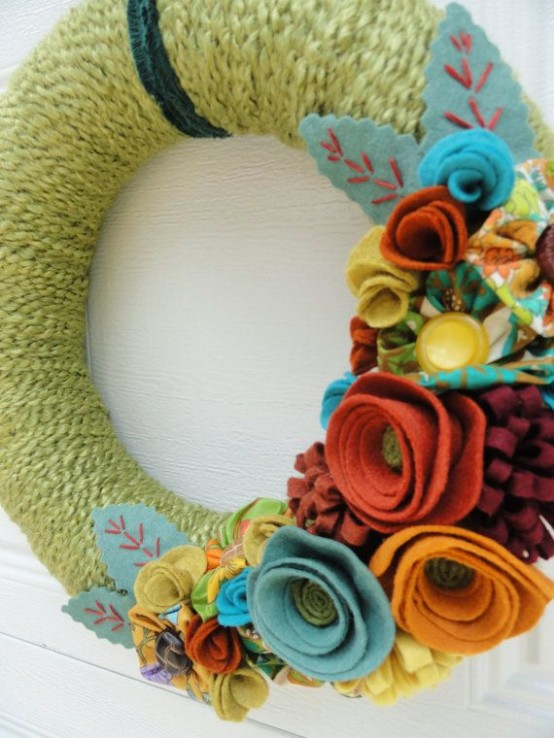 a bright fall wreath with green yarn, colorful fabric blooms and leaves is an easy DIY