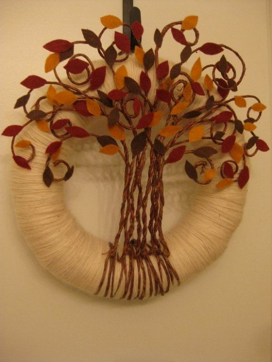 a unique fall wreath covered with neutral yarn, a tree with colorful fabric leaves and twine is a bold idea