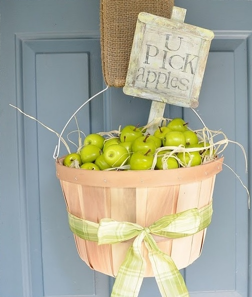 If you're into wreaths you can put some apples in a bucket and hang it on your door instead.