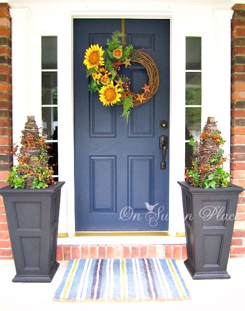 A DIY twig wreath with some faux sunflowers would add a splash of color to your door.