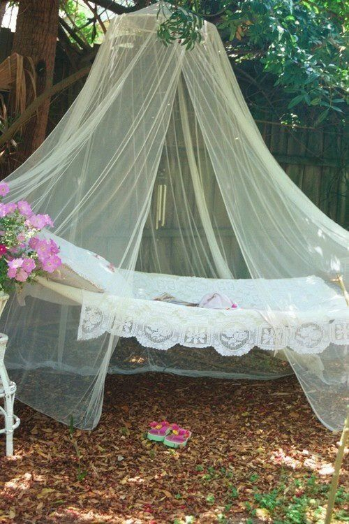 an outdoor hammock covered with a large mosquito net to nap and avoid the bugs during sleeping