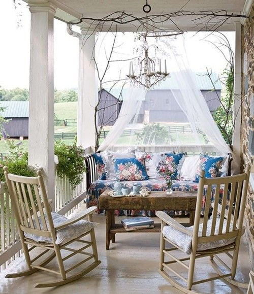an upholstered floral bench with a mosquito net over it is a very refined idea with a touch of vintage
