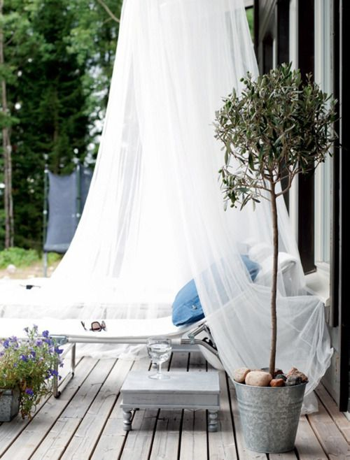 a lounger covered with a mosquito net will help you avod excessive sunshine, bugs and will give a more relaxed feel to your space