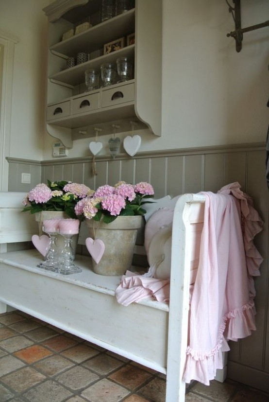 a shabby chic entryway done in neutrals, a shelving unit, a wooden bench, a tiled floor
