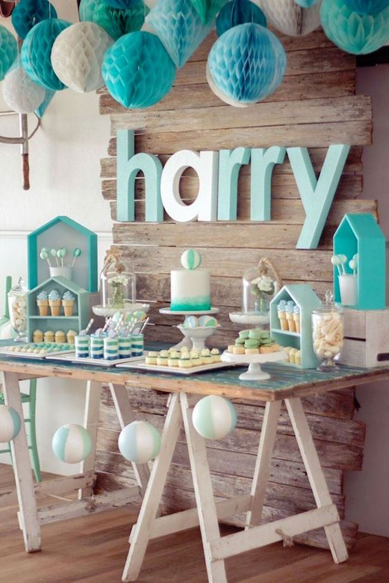 Baby Shower Room Set Up Ideas a turquoise and white baby shower dessert table with paper pompoms, house-shaped  shelves