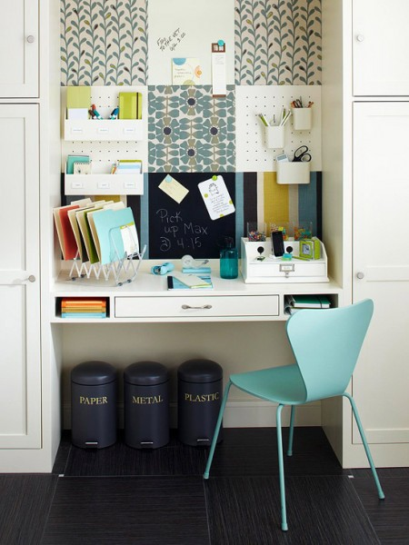 Cute built-in working desk surrounded by storage units.
