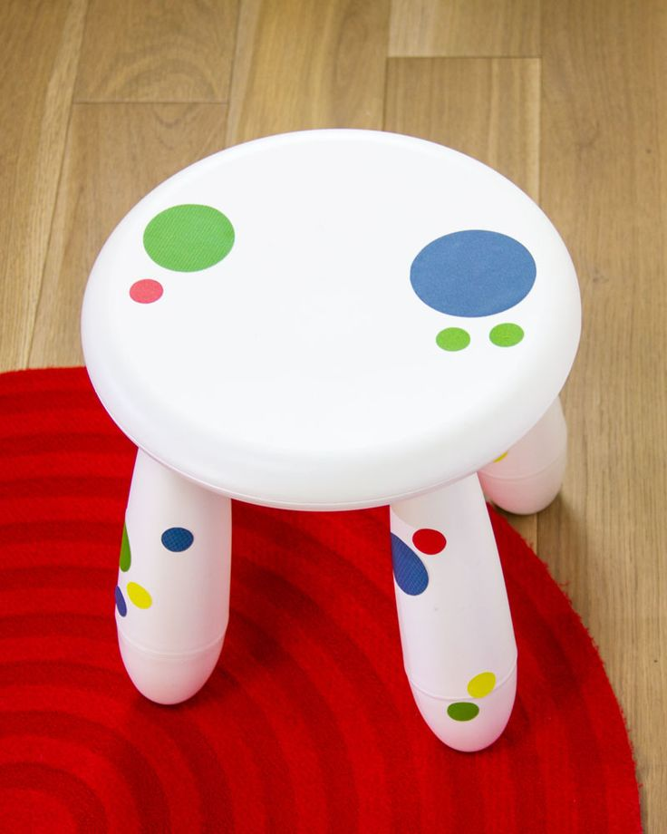 a white IKEA Mammut stool with colorful polka dots is a bold and cool idea   add removable stickers to make it bolder
