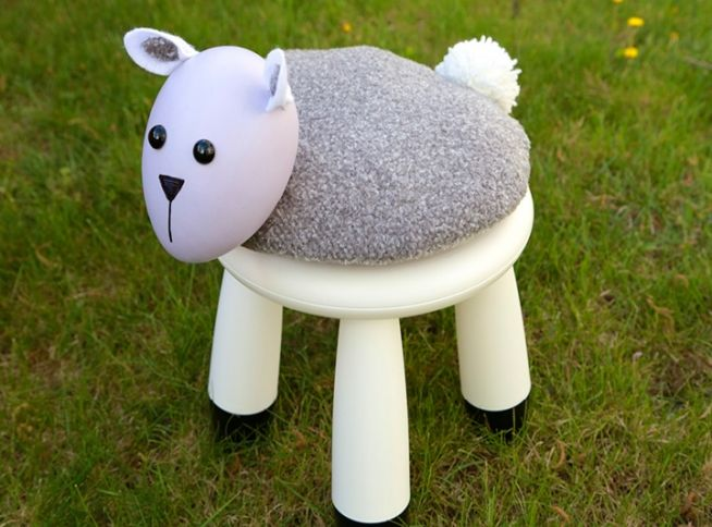 a white IKEA Mammut stool spruced up with a sheep like pillow on top will look fun and cheerful