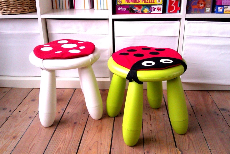 green and white IKEA Mammut stools with lady bug pillows on top for sitting comfortably on them