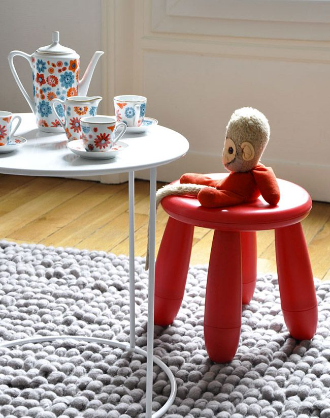 a bright red IKEA Mammut chair will give a touch of color to your space and will make it bolder