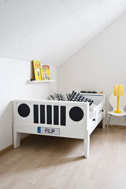 a neutral kid's room with a white Sundvik bed turned into a little car and yellow touches for a bold look