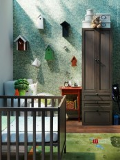 a whimsy nursery with dark stained furniture, an IKEA Sundvik crib, blue and green touches and whimsy decor