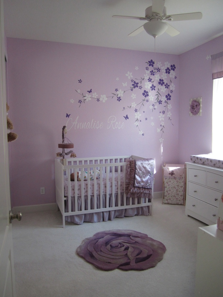 a romantic white and lavender nursery with a white IKEA Sundvik crib, florals on the floor and walls