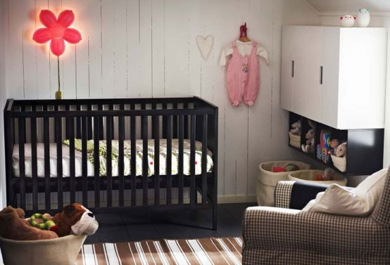 a monochromatic nursery with copper touches and a black IKEA Sundvik crib plus neon lights