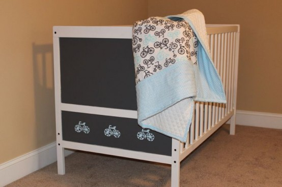 a white IKEA Sundvik crib with a chalkboard side is a cool idea for any nursery and it inspires the kid to be creative
