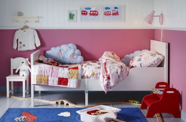 a white IKEA Sundvik bed is a base for this colorful nursery in red, pink and blue