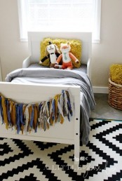 a cozy kids' room with a printed rug, a white Sundvik bed and colorful touches is a welcoming area