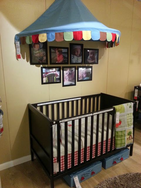a cheerful circus themed yellow and blue nursery with a dark IKEA Sundvik crib and dark frames for the pics