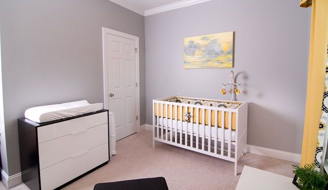 a cozy pastel nursery with lavender walls, yellow touches and an IKEA Sundvik crib integrated perfectly