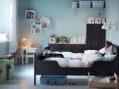 a shared pastel blue nursery with dark stained furniture and IKEA Sundvik beds plus some white items