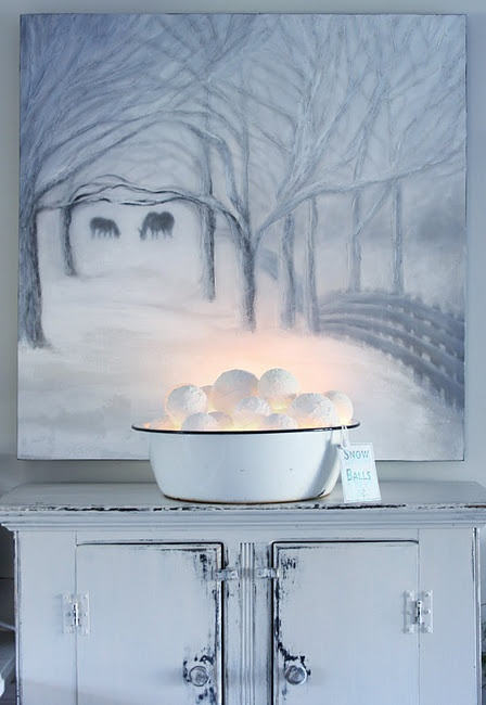 a metal bathtub with lit up snowballs and a tag is a fun rustic decoration for any winter space