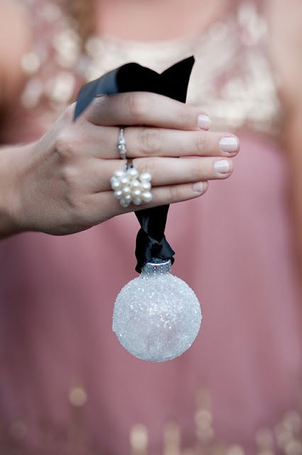 a mini snowball Christmas ornament on a black silk ribbon will be great for your tree or to accent some wrapped Christmas gifts