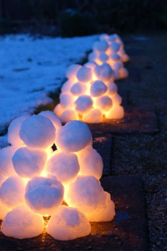 snowball and light piles for decorating outdoors, to line a path and make it look very Christmassy