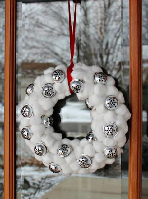 a snowball and bell Christmas wreath on a red ribbon is a lovely outdoor Christmas decoration