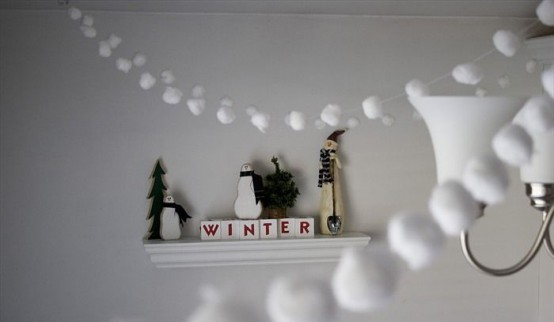 white snowball garlands over the space bring a cozy winter feel to any space and are easy to make