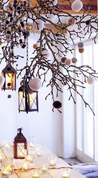 branches with yarn snowballs and lanterns on chains will be a gorgeous overhead winter decoration to rock