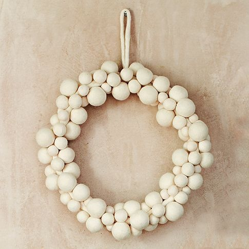 an elegant white snowball Christmas wreath is a simple and cool decoration for your front door