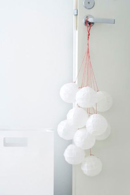 snowballs hanging on the door are a cool and cute way to add a winter feel to the space