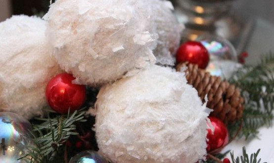 winter decor with snowballs, fir twigs, pinecones and mini red ornaments is a lovely winter decoration or centerpiece