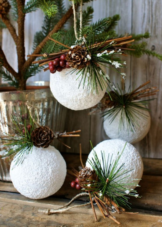 snowballs with fir twigs, pinecones, berries and twigs are great Christmas ornaments or just decorations