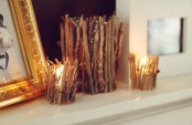 candleholders covered with twigs and sticks for a fall woodland touch in the space