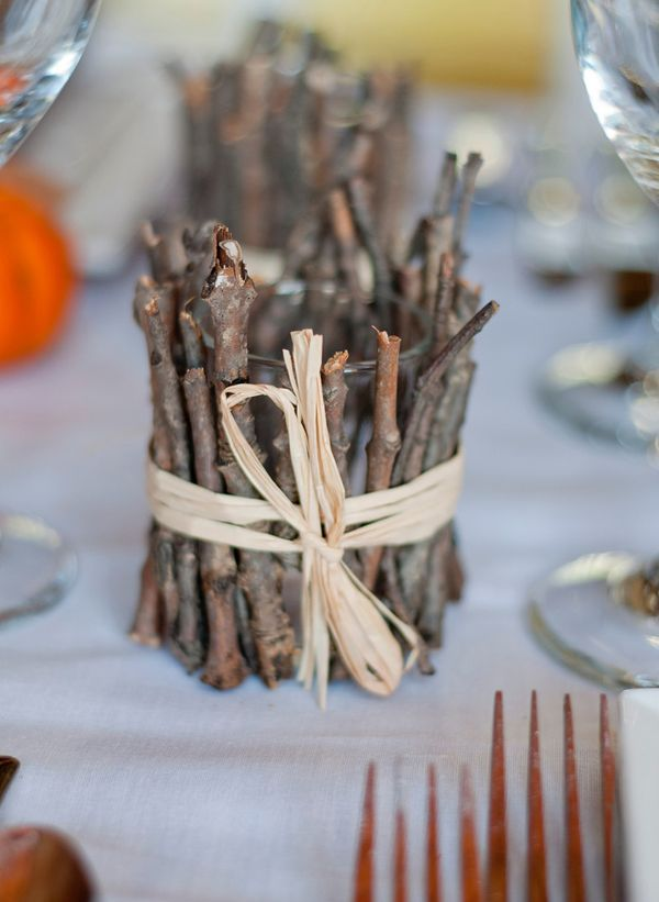 a candleholder covered with sticks and twigs is a cool decoration for woodland or rustic touch