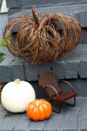 a twig fall pumpkin is a cool and easy natural decoration for indoors or outdoors