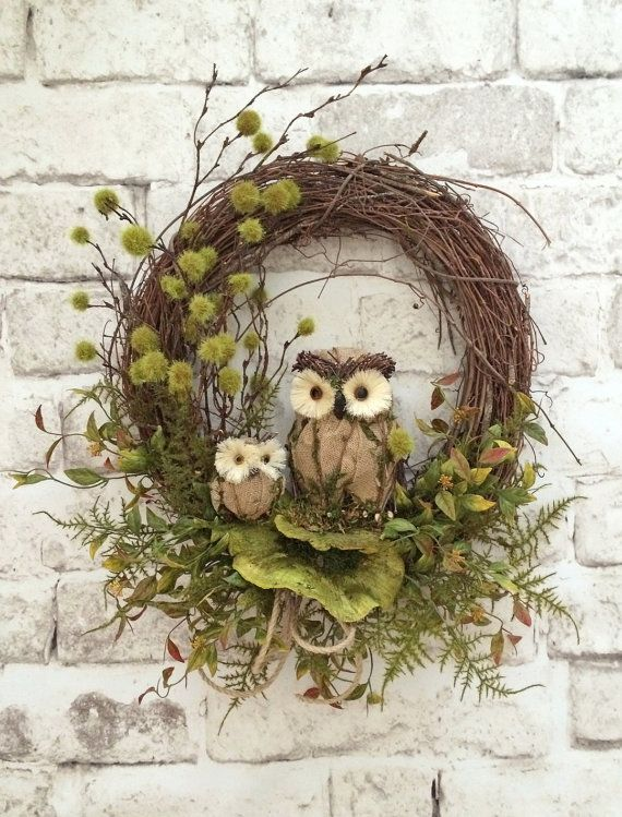 a fall woodland wreath of vine with twigs, greenery, faux leaves and owls is a nice nature inspired decoration