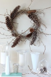 a vine and twig wreath with pinecones is a lovely and all-natural fall to winter decoration
