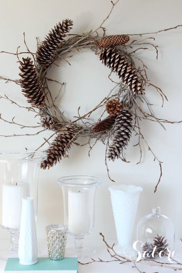 a vine and twig wreath with pinecones is a lovely and all natural fall to winter decoration