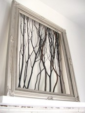 a silver frame with twigs and sticks is a cool decoration with a touch of woodland and glam