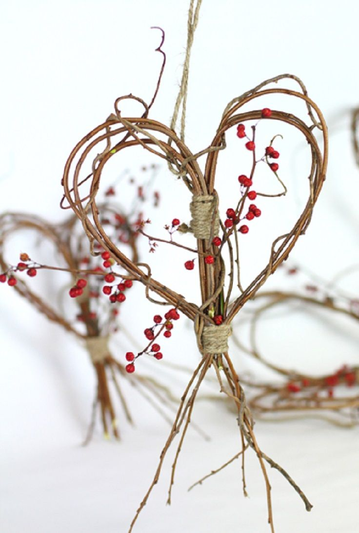 a branch and twig heart wreath with berries and twine is a cool fall decoration to go for