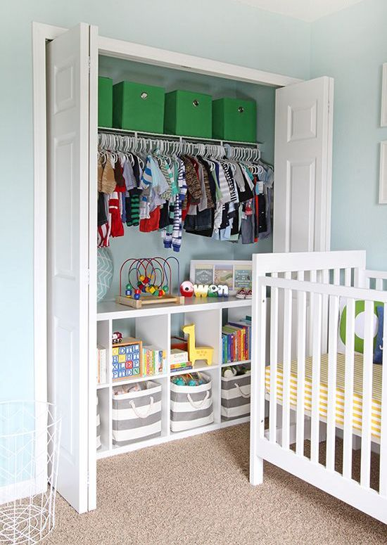 a closet organized with lots of boxes, baskets, clothes hangers s a comfy idea